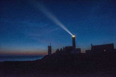 Abbey ruin and lighthouse by night, Pointe de Saint-Mathieu, Brittany, France, Europe