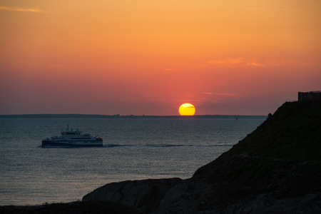 Sunset, Cruiser boat in silhouette, Brittany, France Stock Photo