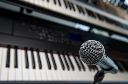 midi: Studio room with synthesizer and microphone equipment.