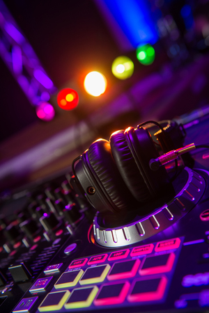 Dj mixer with headphones at a nightclub Stock Photo