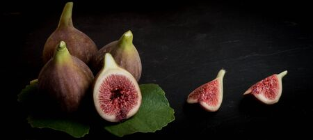 Fresh figs and leaf on isolated on black background, 2017