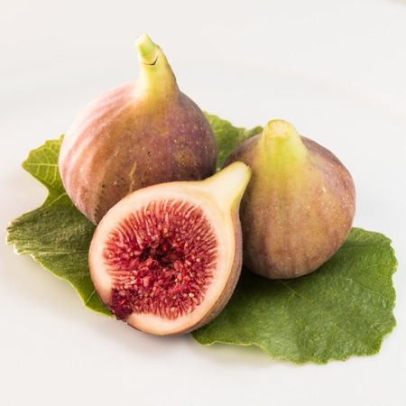Fresh figs isolated on white background.