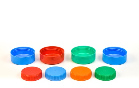 Plastic bottle screw caps isolated on white background Imagens