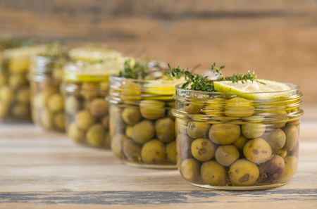 Green olives preserved in jar, preserve Stock Photo