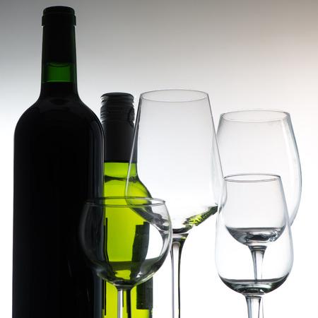 Set of wine bottles and glasses on grey background, france Stok Fotoğraf