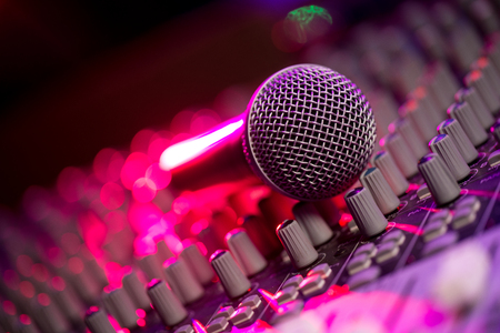 Microphone and Headphones on dirty sound mixer panel, France