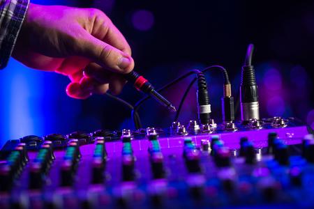 Audio jack Dj mixer dj mix music on the console the dj s hand , france Stock Photo