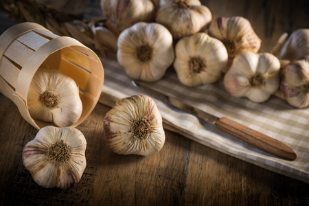 Garlic Cloves and Garlic Bulb on vintage wood background, France