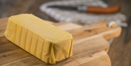 Butter on a wooden plate ready to eat. Food concept Stock Photo