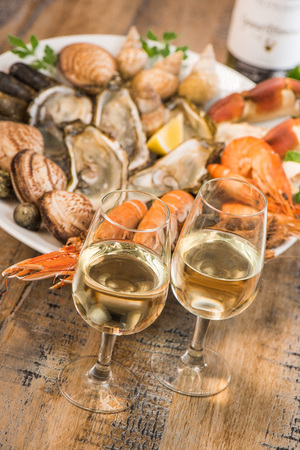 Fresh seafood platter with lobster mussels and oysters and white wine Stock Photo