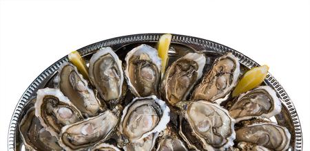 fresh oysters dishing up with lemon on white background, France