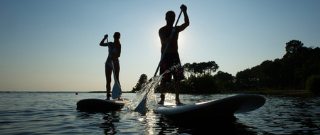 Family Having Fun Stand Up Paddling Together Stock fotó