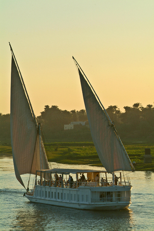 Egypt, Nile Valley, boat cruising on the Nile between Luxor and Aswan. 스톡 콘텐츠