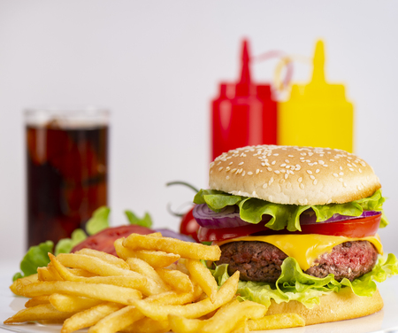 Burger with French fries cutlet with cheese and tomato Archivio Fotografico