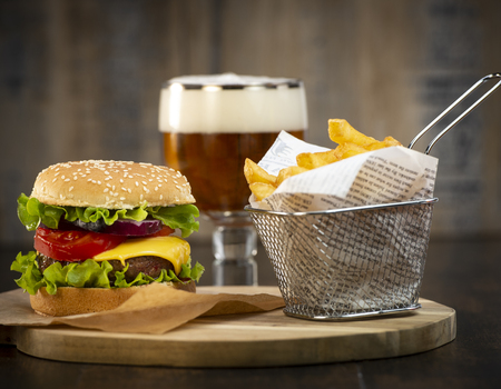 Burger with French fries cutlet with cheese and tomato, France Stock Photo - 117720105