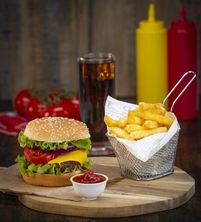 Burger with French fries cutlet with cheese and tomato, France Stock Photo