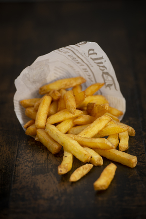 French fries in a paper bag with sauces, France