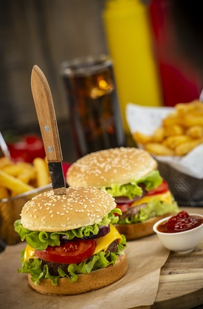 Burger with French fries cutlet with cheese and tomato, France Stock Photo - 117720289