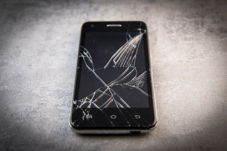 Smartphone with broken screen, broken phone Stock Photo - 122079165