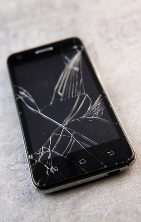 Smartphone with broken screen, broken phone