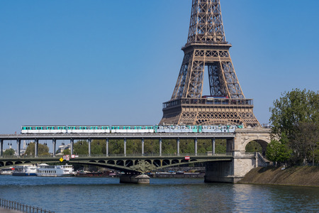 Paris metro crossing Pont de Bir-Hakeim and Eiffel Tower, France Stock Photo