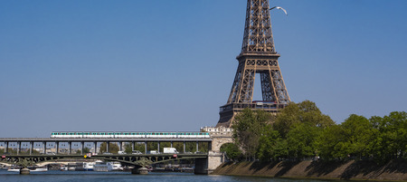 Paris metro crossing Pont de Bir-Hakeim and Eiffel Tower, France