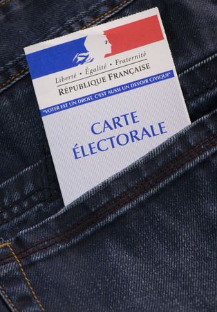 French electoral voter card official government allowing to vote paper in jeans back pocket Stock Photo