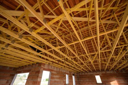 Residential construction home framing view on new house wooden under construction