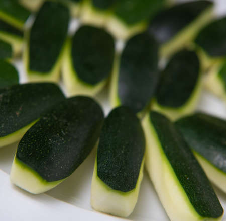 Preparing fresh courgette, zucchini on wood table