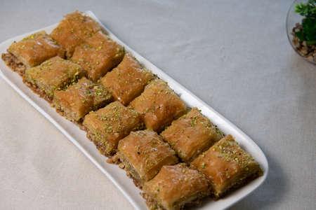 Baklawa on a plate on a table, top view, baklava, feast treat ramadan traditional dessert