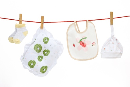 baby socks and pillow and bib and cap hanging Stock Photo