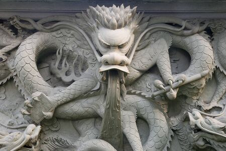 stone carving: a mighty stone carving dragon Stock Photo