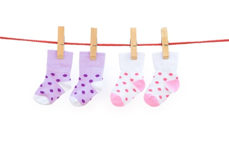 two pairs baby socks hanging