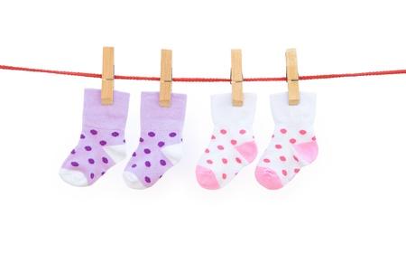 two pairs baby socks hanging