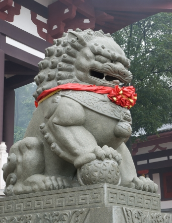 fengshui: fengshui lion with red ribbon Stock Photo