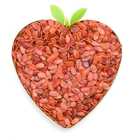heart shaped red melon seeds Stock Photo