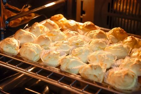 mini oven: mini muffins baking in the oven Stock Photo