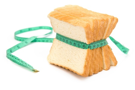 bread grasped by measuring tape Stock Photo