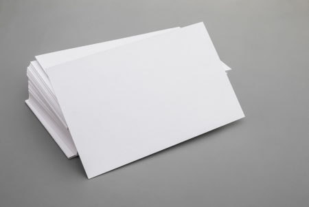 blank business cards stack up on grey background photo