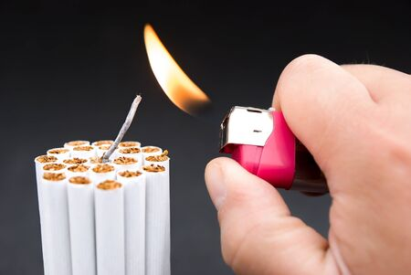 igniting: igniting a bundle of cigarettes with tinder