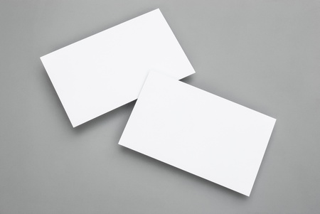 blank business cards on grey background Stock Photo