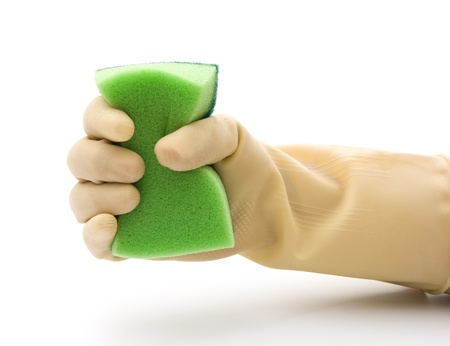 grabing: grabing a double side green cleaning sponge