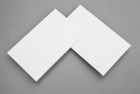 blank business cards on grey background photo