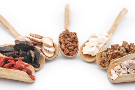 chinese herbs on wooden spoons Stock Photo