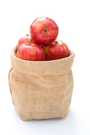 gunny bag: fresh apples in gunny bag on white