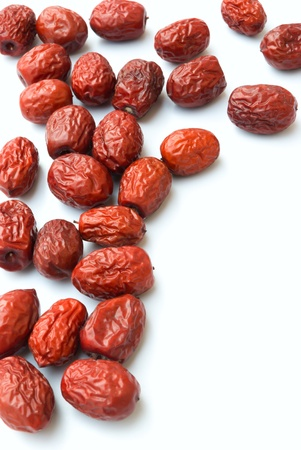 lots of dried jujube on white background
