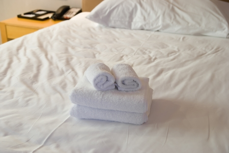 towels on bed in a hotel room