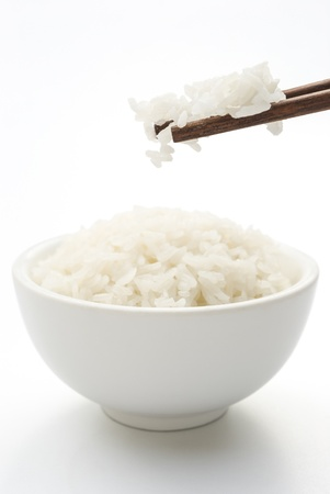 rice and chopstick on white , vertical composition