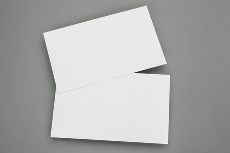 stack of business cards: blank business cards on grey background Stock Photo