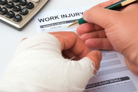 filling up a work injury claim form photo